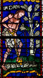 Adam working in the field. Stained glass window of Adam Royalty Free Stock Images