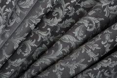 Adamaszek, falisty czarny tekstury tło zdjęcia stock