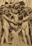 Adame and Eve. Detail on Notre Dame de Paris Cathedral fachade: Adame, Eve and the forbidden apple Stock Photography
