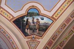 Adame, Eve und Schlange im Himmel Stockfotos
