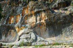 Adamkayalar - rock carved figures. Turkey Stock Photo