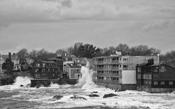Adams House. This is a rough sea smashing against the Adams House Apartment Building Stock Photo