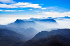 Adams Peak sunrise view. Foggy mountains aerial panoramic view from the Adams Peak or Sri Pada on sunrise. Adams Peak is a tall and holy buddhist mountain in Sri stock images