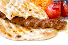 Adana Kebab. Traditional Turkish Kebab served with pita bread on white background Stock Image