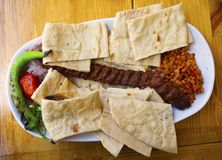 Adana Kebab. & x22;Adana Kebab & x22;& x28;minced& x29;, Adana / Turkey is a special kebabs. sheep meat is chopped with a sharp knife called armor findings pita royalty free stock image