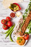 Adana Kebab Served with Green Vegetables in  White Plate Stock Photos