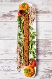 Adana Kebab Served with Green Vegetables in  White Plate Royalty Free Stock Image