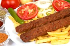 Adana kebap. With french fries and salads Royalty Free Stock Photo