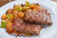 Adana kofte with vegetables Stock Photos