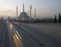 Adana Mosque. Speeding traffic on the road in front of the Adana Mosque in Turkey Royalty Free Stock Photography