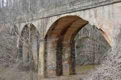 Adandoned arch bridge in rural south USA. Abandoned arch bridge in rural South Carolina is pictured. The year constructed is unknown but bridges in the USA once Stock Photo