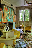 Adandoned trashed house with graffifi on walls. Adandoned, messy and trashed house interior with graffifi on walls Stock Image