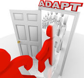 Adapt People March Through Doorway Adapting to Change. Many people step through a doorway marked Adapt to illustrate changing or innovating to succeed in life or Stock Image