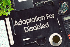 Adaptation For Disabled on Black Chalkboard. 3D Rendering. Stock Photo
