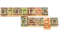 Adaptive design in wood type. Adaptive design - website development concept - isolated text in letterpress wood type royalty free stock image
