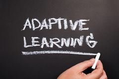 Adaptive Learning on Chalkboard. Hand writing topic of Adaptive Learning on chalkboard stock images