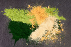 Adaptogen background. Ground powdered ashwagandha, chlorella, maca and barley top view. Superfood concept Stock Images