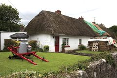 House with a thatched roof. Adare Ireland, - July 20, 2016: House with a thatched roof, Adare, County Limerick, Ireland Stock Images