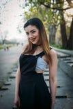 Adatti il modello grazioso della donna che indossa una parte posteriore sarafan Fotografia Stock Libera da Diritti