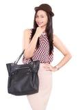 Adatti il retro ritratto della giovane donna alla moda con la borsa di cuoio Immagine Stock Libera da Diritti
