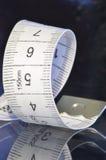 Adatti la spirale del nastro di misura Immagini Stock Libere da Diritti