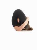 Adavanced contorted yoga poserar royaltyfria foton