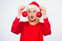 Add decorative detail holiday. New year decor concept. How decorate for winter. Christmas tree decoration ideas. Woman. Wear santa hat hold two balls decor royalty free stock photos
