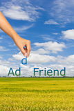 Add friend. Hand putting alphabet, rice field and blue sky background, add friend concept royalty free stock photos