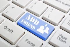 Add friend on keyboard Stock Photo