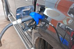 Add fuel oil to the car in the fuel pump with a dispenser.selec. T focus Stock Photography