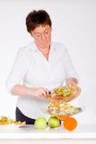 Add the kiwi into the salad Royalty Free Stock Photos