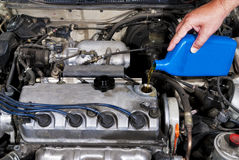 Add oil to keep your engine healthy Royalty Free Stock Images