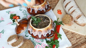 Add salt to the soup in a pot on a Russian holiday table. stock footage