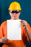 Add text here. The man in yellow helmet, orange shirt, glasses and paper a4. Add your text here. Isolated glasses, paper and background in different paths Royalty Free Stock Image