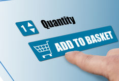 Add to basket. Customer adding to basket on line shopping Royalty Free Stock Photography