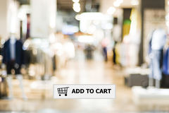 Add to cart on address bar over blur store background. Shopping online, e-commerce, web banner Royalty Free Stock Photo