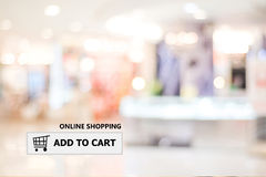 Add to cart on address bar over blur store background. Shopping online, e-commerce, web banner Royalty Free Stock Photos