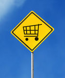 Add to cart sign. Yellow sign with add to cart symbol on blue sky background Royalty Free Stock Photo