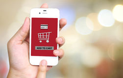 Add to cart on smart phone screen in hand, e-business concept Stock Image
