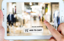 Add to cart on tablet screen, business, E-commerce. Add to cart over blur store with people background on tablet screen, business, E-commerce, on line shopping royalty free stock photo