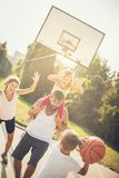 Add to me. Family playing basketball royalty free stock images