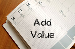 Add value write on notebook Stock Photo
