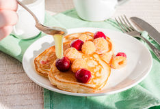 Add vanilla pancakes with cherry and raspberry Royalty Free Stock Images