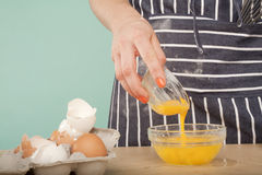 Add the yolk Royalty Free Stock Image