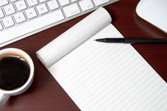 Add your own message. Blank notepad sitting at a work station ready for someone to add their own message Stock Photo