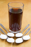 Added sugar in fizzy drinks. The approximate number of teaspoons of sugar  added to fizzy drinks Stock Image