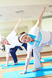 Addestrando in ginnastica Fotografia Stock Libera da Diritti