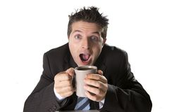 Addict businessman in suit and tie holding cup of coffee as maniac in caffeine addiction Stock Photography