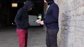 Addict buying dose from drug dealer on street 7. Drug trafficking, crime, addiction and sale concept - addict buying dose from drug dealer on street stock video