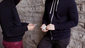 Addict buying dose from drug dealer on street 33. Drug trafficking, crime, addiction and sale concept - addict buying dose from drug dealer on street stock video footage